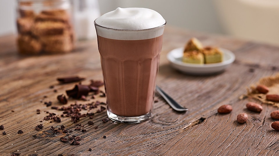 glass-with-hot-chocolate-on-wooden-table.jpg