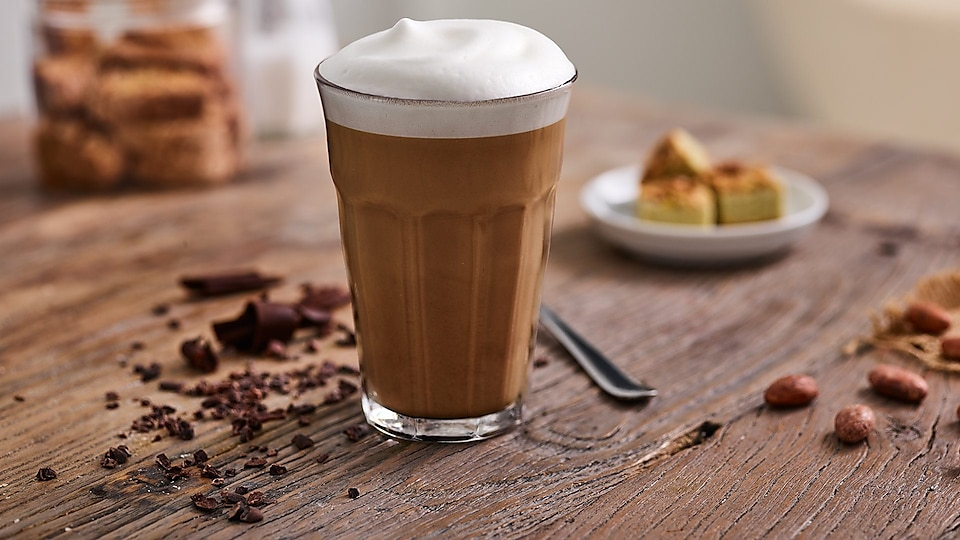 glass-with-mochaccino-on-wooden-table.jpg